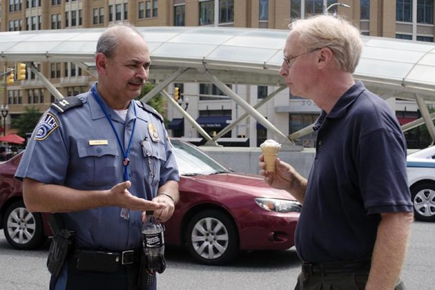 An ACPD officer chats with a man