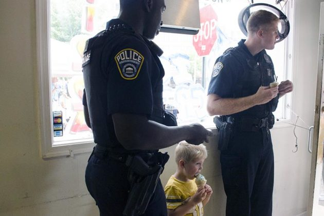 ACPD officers and a boy have ice cream
