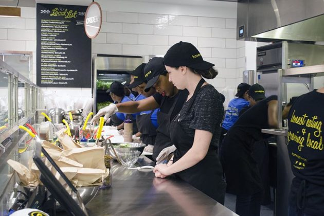 Employees create meals during the Honeygrow preview lunch