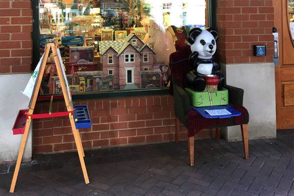Mr. Panda fills in for the stuffed bear outside of Kinder Haus Toys in Clarendon (photo courtesy Eric LeKuch)
