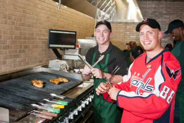 Caps defenseman Nate Schmidt mans the grills at Nando's