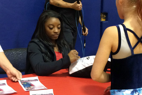 Simone Biles visiting Arlington gymnasts - photo courtesy Arlington Dept. of Parks and Recreation