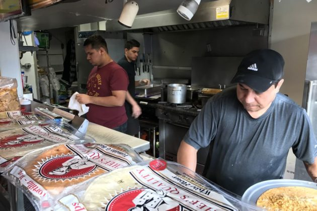 Richard Arnez (right) still slings the same burritos