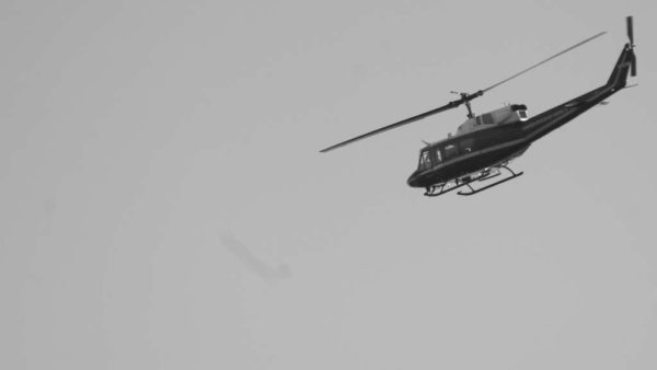 Government helicopter against a gray sky (Flickr pool photo by John Sonderman)