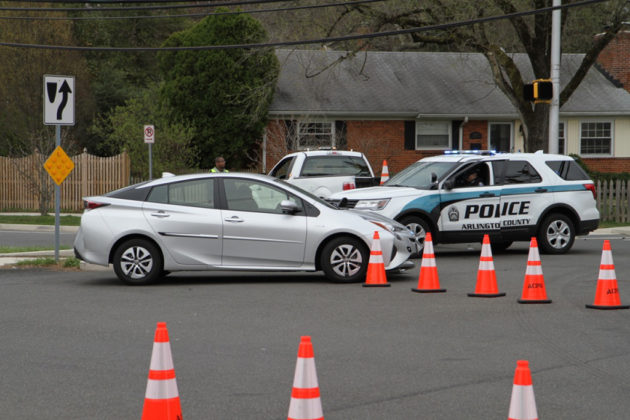 Police set up cones and directed traffic around the white Prius