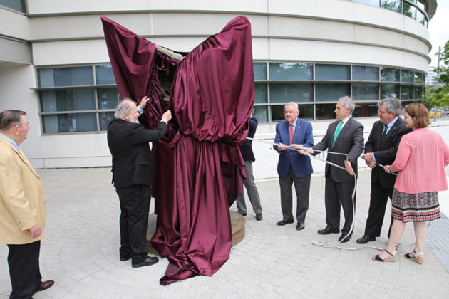 Wyatt (far left) assists with the unveiling