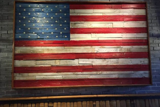 A large American flag in the bar area (photo via Facebook)