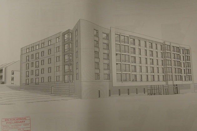 The proposed affordable housing units with townhomes in the background