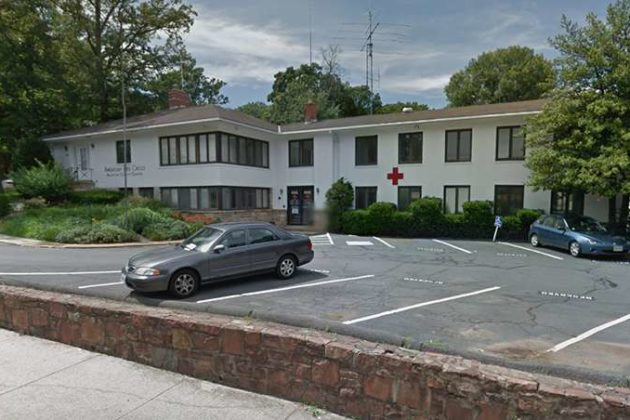 The proposal would replace the Red Cross building and two homes (photo via Google Maps)