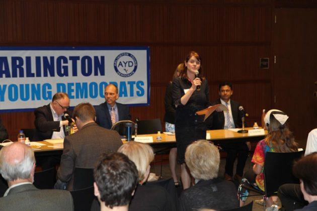 Arlington Young Democrats president Maggie Davis kicks off the forum