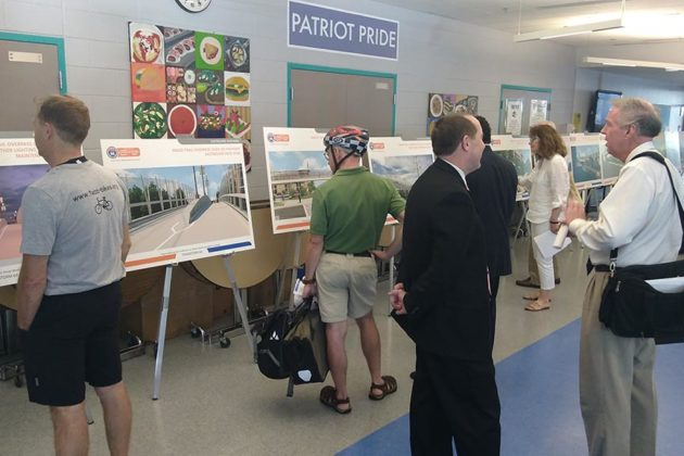 Attendees examine renderings at Yorktown High School Tuesday night