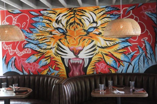 Throughout Bar Bao, murals have been drawn by two graffiti artists