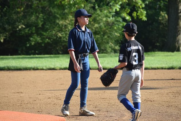 Isabel Graham umpiring a recent AAA Little League game