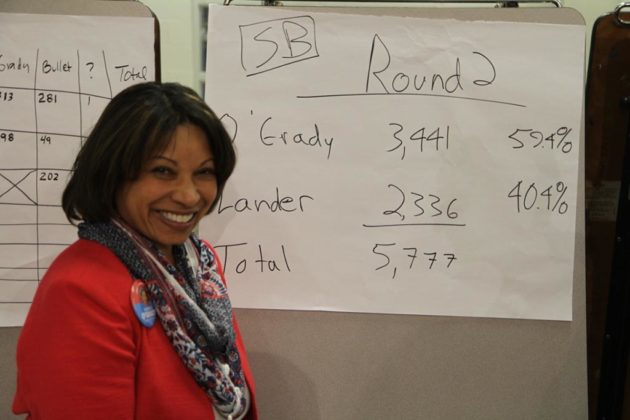 Monique O'Grady in front of the caucus results