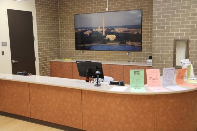 The center's circulation desk has been moved and been redecorated