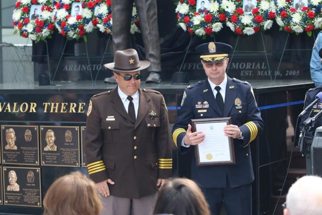 Police Chief Jay Farr and Chief Deputy Sheriff Paul Larson with the proclamation