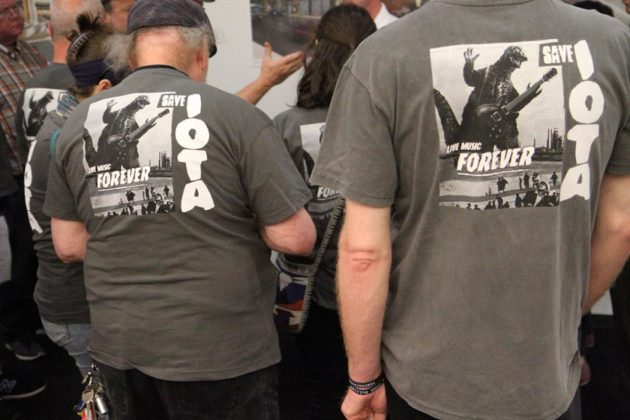 Supporters of IOTA wore matching T-shirts to the open house