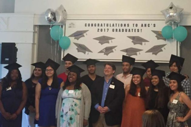 Del. Alfonso Lopez (D) gathers with the graduates