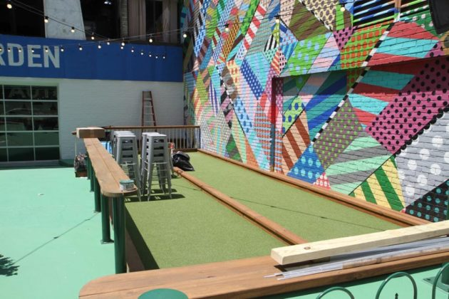 The space includes two bocce courts
