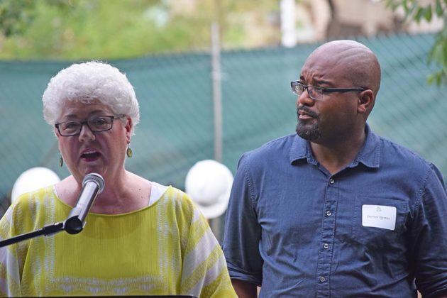 Susan Etherton and Derrick Weston of the church speak at the ceremony