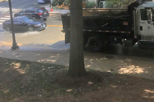 The water main break on N. Oak Street (via Twitter user @lizvanwazer)