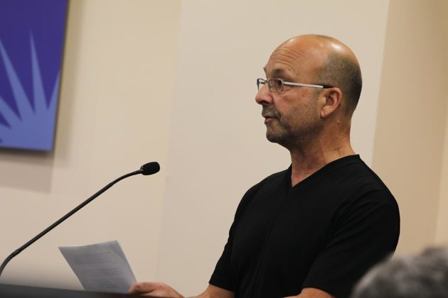 Marc Beallor testifies before the School Board