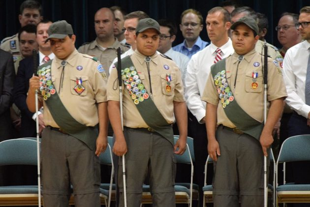 The Cantos brothers receive their Eagle Scout pins