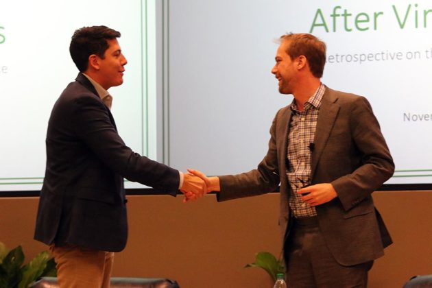 The two campaign managers shake hands after the forum