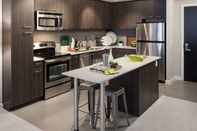 TELLUS: Stainless steel appliances and kitchen island with bar seating