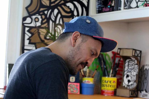 Mas Paz works in his studio office at home in Arlington.
