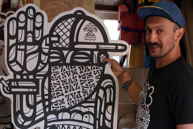 Mas Paz poses with one of his pieces.